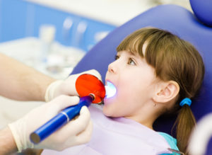 Little girl getting a dental filling