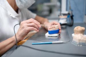 Dentist making dentures