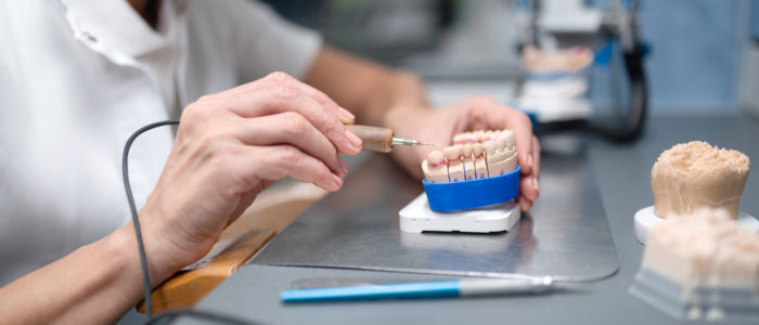 Dentist making dentures