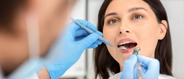 Female patient receiving a dental checkup